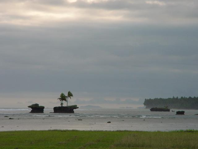 Mini-islands, off the shore of Vanua Levu, Fiji in August 2001 - Click for larger image (https://jamesmcgillis.com)