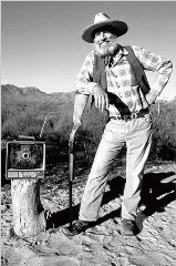 This photo of Edward Abbey, by Mike Essig is a classic, displaying Ed's feelings about electronic technology and TV, in particular - Click for larger image (http://jamesmcgillis.com)