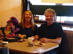Author Jim McGillis and Plush Kokopelli present the World Citizen Award to Ms. Kristi Frazier in Flagstaff, Arizona - Click for larger image (http://jamesmcgillis.com)