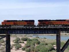 """BNSF to the Rescue"" - Metrolink will lease up to fifty-eight heavy locomotives, as seen here crossing the Colorado River at Needles to head up all Metrolink trains in the future - Click for larger image (http://jamesmcgillis.com)"
