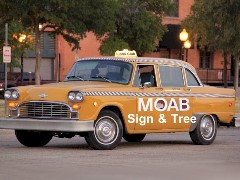 The Big Yellow Taxi, owned by Moab Sign & Tree Removal visited Moab Lions Park in 2012, promoting removal of all historically significant signs and trees at that location - Click for larger image (http://jamesmcgillis.com)