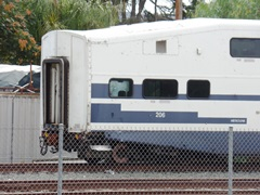 Obsolete Bombardier bi-level coach No. 206 popped both its couplings and careened off the tracks during the February 2015 Metrolink Oxnard collision - Click for larger image (htttp://jamesmcgillis.com)