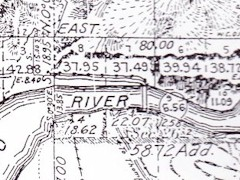 "This 1880 survey of the Moab Valley shows the ferry crossing near the ""jumping off place""  and current U.S. Highway 191 bridge - Click for larger image (http://jamesmcgillis.com)"