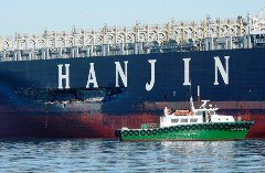 Hanjin COSCO Busan ocean freighter, showing 90-foot Gash in its hull, San Francisco Bay, California - Click for larger image (http://jamesmcgillis.com)