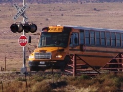 A school bus returns to U.S. Highway 160 at Cow Springs, Arizona - Click for larger image (http://jamesmcgillis.com)
