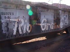 An old Denver & Rio Grande Railroad flatcar is coupled to the Burro Crane at Seven Mile - Click for larger image (http://jamesmcgillis.com)