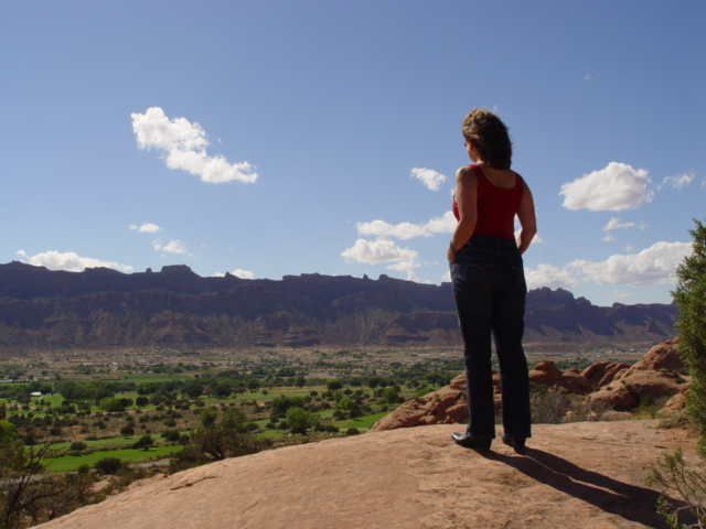 Spokesmodel Carrie McCoy, overlooking the Spanish Valley and Moab Rim beyond - Click for larger image (http://jamesmcgillis.com)