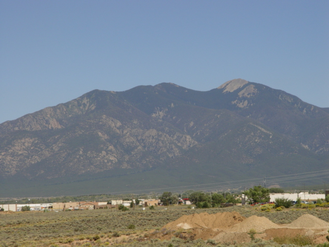 Taos and the mountains beyond - Click for larger image (http://jamesmcgillis.com)