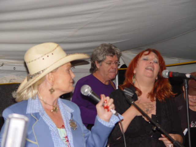 Brigitte London (right), singing with Grammy Winner and Country Legend, Lynn Anderson - Click for larger image (http://jamesmcgillis.com)