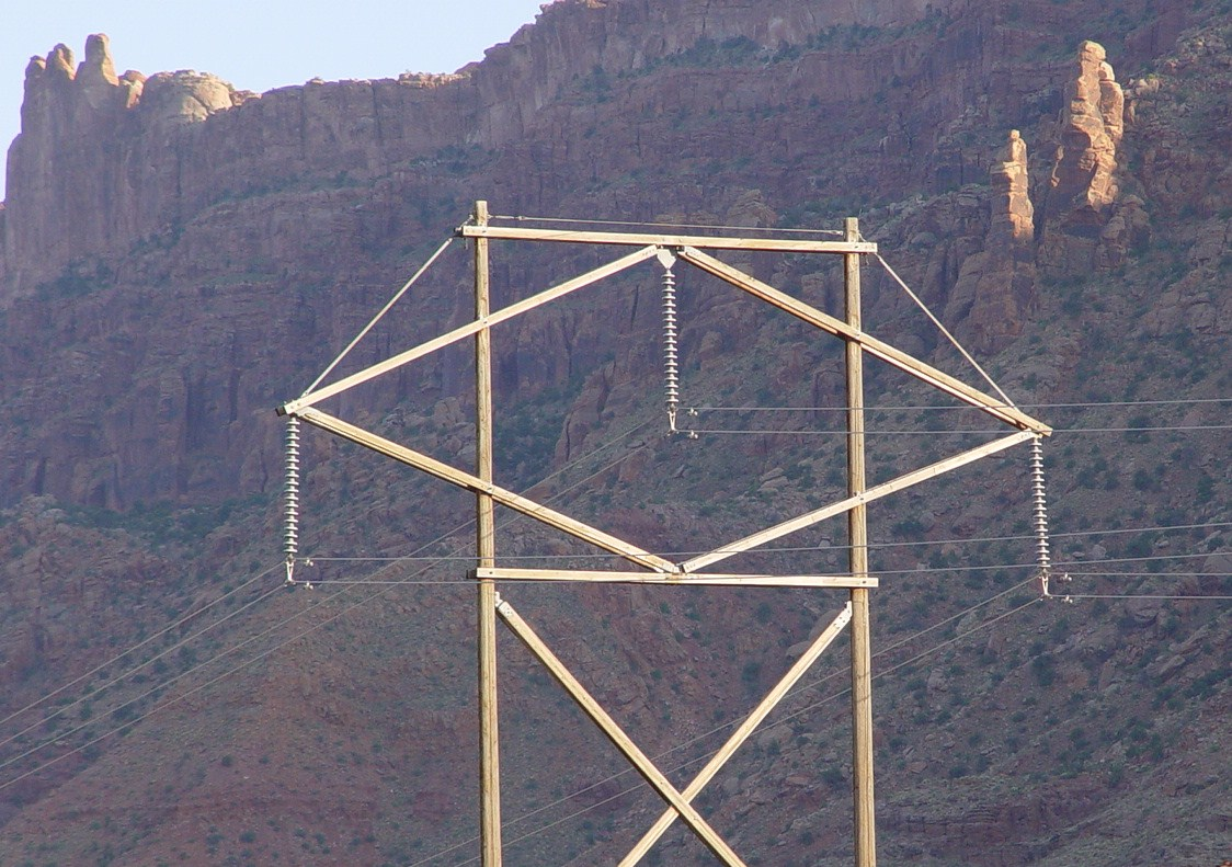 Originating at a coal-fired power plant near Price, Utah, high voltage power lines parallel the Moab Rim, heading south past Moab, Utah (http//jamesmcgillis.com