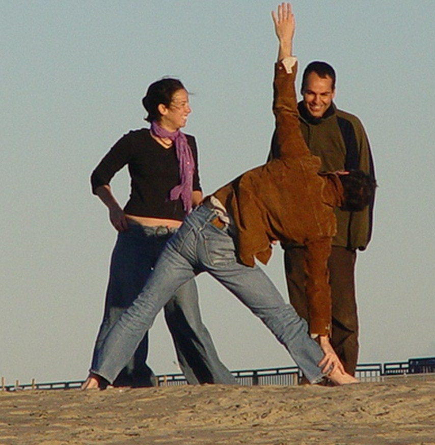 Yoga practitioner demonstrates a stretching move on a winter day, Venice Beach, California (http://jamesmcgillis.com)