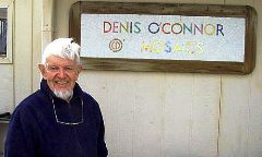 Artist, Dennis O'Connor (1934 - 2008) in front of a self-titled mosaic nameplate, at home in Anza, California (http://jamesmcgillis.com)