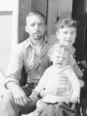 Edward Abbey, wife Rita Deanin Abbey and son Joshua at Edward Abbey's trailer, Arches National Monument ca.1956 - Click for larger image (http://jamesmcgillis.com)
