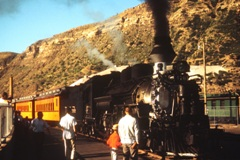 Durango, Colorado Depot in 1965 - Engine No. 476 at full steam - Click for larger image (https://jamesmcgillis.com)