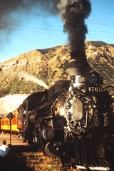 With its steam whistle blowing photographers off the track, Engine No. 476 departs Durango Depot in 1965 - Click for larger image (http://jamesmcgillis.com)