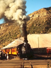 With a blast of steam up the chimney, Engine 476 moves out of Durango Depot in 1965 - Click for larger image (http://jamesmcgillis.com)