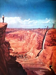 A 1961 view of Glen Canyon, before the 710 foot tall Glen Canyon Dam filled the space delineated by the bridge with concrete. Note giant Navahopi Sipapu installed at the lower right of this image - Click for larger image (http://jamesmcgillis.com)
