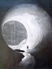 Unwittingly, the U.S. Bureau of Reclamation installed a giant Navahopi Sipapu in the base of Glen Canyon Dam in 1961 - Click for larger image (http://jamesmcgillis.com)