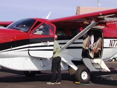 The Redtail Aviation Kodiak 100 features three doors, including a double-wide passenger/cargo door. Note that under-belly luggage compartment door does not conflict with open passenger door - Click for larger image (http://jamesmcgillis.com)
