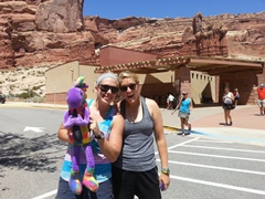 On a hot summer day, Plush Kokopelli greets two fans at the Visitors Center of Arches National Park, Moab, Utah. What a thrill for all concerned - Click for larger image (http://jamesmcgillis.com)