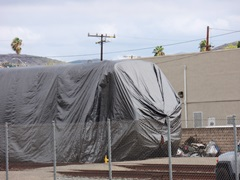 Metrolink's Hyundai Rotem Cab Car No. 645, which was involved in the February 2015 Oxnard collision is tarped and hidden on an SCRRA spur in Moorpark, California - Click for larger image (http://jamesmcgillis.com)