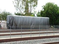 "Shrouded in mystery, this Hyundai-Rotem ""Guardian"" coach was derailed and toppled in the February 2015 Metrolink Oxnard collision - Click for larger image (http://jamesmcgillis.com)"