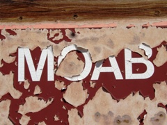 The old Moab Sign, at the intersection of Highways 191 and 128 in Moab was secretly destroyed one night in 2015 - Click for larger image (http://jamesmcgillis.com)