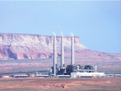 From Wahweap Overlook, the Navajo Generating Station and its 775 foot tall flue stacks seem to fade into the hazy background - Click for larger image (http://jamesmcgillis.com)