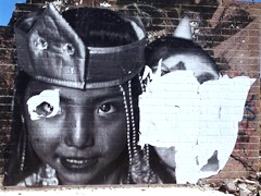 """Navajo Girl"", a wheat paste photo-mural at Cow Springs, Arizona, as she stood in 2012. To see the deconstruction of art at the Cow Springs Trading Post, click for a larger image (http://jamesmcgillis.com)"