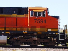 A typical BNSF freight locomotive has three heavy axles and wheel-sets up front, plus a large anti-derailment plow and heavy steel to protect the operator - Click for larger image (http://jamesmcgillis.com)