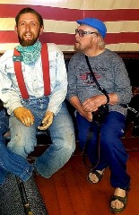 In 2019, the spirit of Ralph Newcomb (left) sits with Jim (Jimbo) Forrest as they discuss their earlier lives in 1950's New Mexico, The Land of Enchantment - Click for larger image (http://jamesmcgillis.com)
