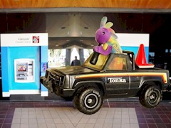 Plush Kokopelli and Coney the Traffic Cone simulate an ATM ram raid with their four wheel drive Tonka truck - Click for larger image (http://jamesmcgillis.com)