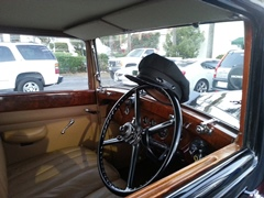 The chauffeur's hat in a Rolls Royce symbolizes Bob Lovejoy's longstanding service to his Santa Barbara, California community - Click for larger image (https://jamesmcgillis.com)