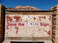 """In a brief 2014 effort to save itself from the wrecking ball, the original """"Moab Sign"""" posted this message on its board - Click for larger image (https://jamesmcgillis.com)"""