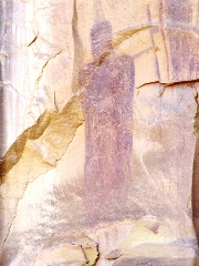 Hooded and robed figure is among the most ancient of the Sego Canyon rock art images, soon to be in peril by a paved road and tar sands development above Sego Canyon, Utah - Click for larger image (http://jamesmcgillis.com)