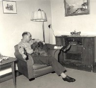 Master Sergeant Joseph Edgar Allen at home in Bad Cannstatt, Germany, ca. 1954. Note C.Proietto original oil painting in the background - Click for larger image (http://jamesmcgillis.com)