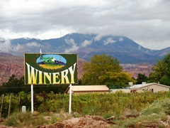 With the dramatic La Sal Range in the background, the Spanish Valley Vineyards & Winery sign, as seen from the Stocks Drive entrance - Click for larger image (http://jamesmcgillis.com)