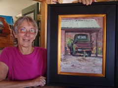 Sue Farrell with the Larry Rudolech painting of Jim Farrell's 1950 Chevrolet 3100 pickup truck - Click for larger image (https://jamesmcgillis.com)