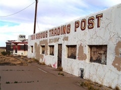 With graffiti poorly painted out, the derelict Twin Arrows Trading Post deteriorates by the side of Old Route 66 - Click for larger image (http://jamesmcgillis.com)