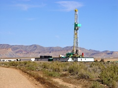 Although the Utah Recreational Land Exchange was supposed to protect more of Greater Canyonlands, Parcel 32 adjacent to Canyonlands Field may soon look like this drill rig near Salt Valley in Grand County - Click for larger image (https://jamesmcgillis.com)