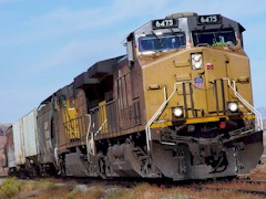 Union Pacific Railroad Engine 6475 transports empty cars along the Potash Branch Lione near URLEA Parcel 32 - Click for larger image (https://jamesmcgillis.com)
