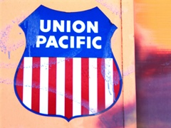 Graffiti-splattered Union Pacific Railroad logo sign on the cab of Burro Crane BC-47 at Seven Mile, near Moab, Utah - Click for larger image (https://jamesmcgillis.com)