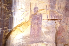 Perhaps one of the oldest rock art pictographs in the world, The Black Knight may represent an Anunnaki God giving birth to a robed human figure, who walks out from his dark cloaks - Click for larger image (htts://jamesmcgillis.com)