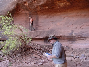 Within the Alcove - As author and naturalist Craig Childs consults his Book of Knowledge, a happy soul rises above at Seven Mile Canyon, Moab, Utah - Click for larger image (https://jamesmcgillis.com)