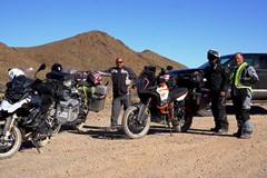 Three adventure motorcycle riders pause on the ascent in Titanothere Canyon, Death Valley National Park - Click for larger image (http://jamesmcgillis.com)