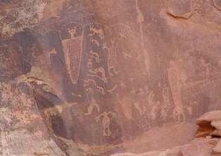 Connecting the Dots - Fremont and Archaic Culture rock art panel depicts an ascended master creating the connection between a wild animal on the left and the kaleidoscope of happy humans, animals and fanciful spirits on the right. - Click for larger image (http://jamesmcgillis.com)