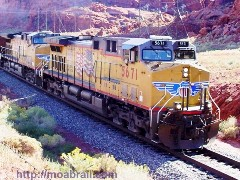 Union Pacific Railraod locomotives pull the uranium mill tailings train to the disposal site - Click for larger image (https://jamesmcgillis.com)