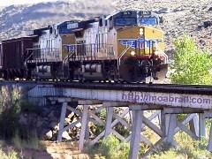 Lead locomotive crosses a steel trestle bridge near Canyonlands Field, Moab, Utah - Click for larger image (https://jamesmcgillis.com)