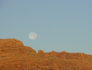 Full moon in the morning, setting over the Moab Rim, Downtown, Moab, Utah - Click for larger image (https://jamesmcgillis.com)