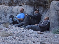 Tired from the long, rough ride through Titus Canyon, the adventure motorcyclists recline and rest against the canyon wall - Click for larger image (http://jamesmcgillis.com)